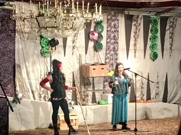 Rosa Lander (right) speaking at JFREJ's Purim Carnival and March.