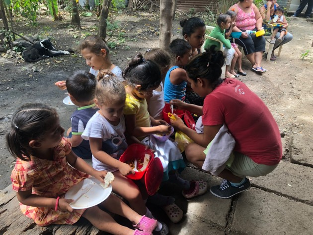 Members of the Women's Network feed children in Tipitapa, Nicaragua. The Women's Network is run by Nicaraguan women and is aiming to become self-sustaining—and not rely on international donations.