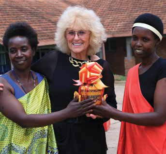 In Rwanda, repaired patients giving Barbara Margolies gifts at a Day of Dignity celebration.