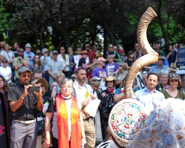 Rabbi Ariel Stone sounds the shofar at a gathering of the Interfaith Clergy Resistance last August.