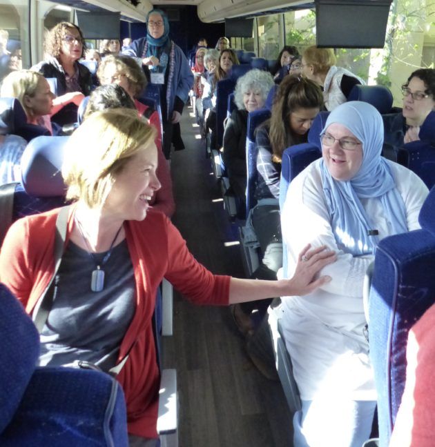 Reaching across the aisle – Cyndy Wyatt (left) and Dorene Alama discovered they both attended the same Catholic school in upstate New York. Cyndy, now living in Stowe, Vt., converted to Judaism. Dorene, in Charlotte, N.C., converted to Islam. Photo credit: Amy Stone