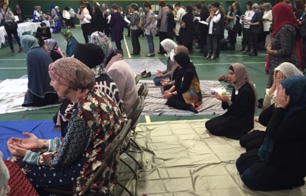 Side by side in prayer, Muslim women (front), Jewish women (back) at Sisterhood of Salaam Shalom national conference. Photo: Amy Stone