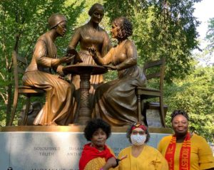 Women in front of the statue.